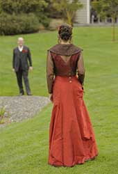 long, glamorous, red wedding dress from the back